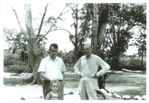 Graham Greene (right, 54 years old) with Dr Michel Lechat (31 years old) and Lechat's two first-born children, Marie and Laurent. Car park in front of the airfield of Coquilhatville, the Belgian Congo, 5 March 1959. Photo reproduced with permission from Edith Lechat.