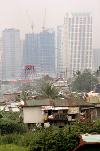 "An urban poor community in an area the government considers ""danger zone"" in Metro Manila. Macky Macaspac/PW File Photo -"