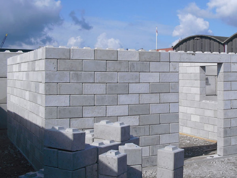 Building homes from plastic bricks waste product homes for Concrete block construction homes